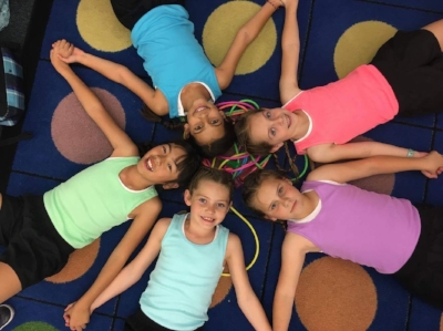 """The Jump Rope Sisters"" performed to the song,  Shake It up . Third Graders Lynn Morishita, Asha Ayres, Abbey Riley, Hadley Mills, and Saige Strickland are pictured (from left to right)."