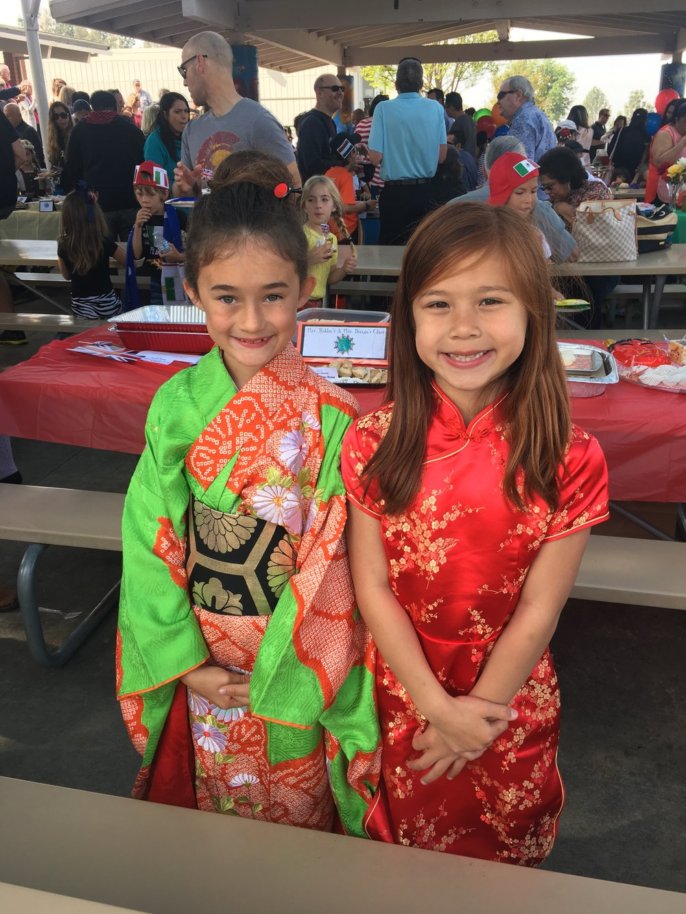 Mia Snow and Marissa Hilde shine in their kimono and qipao. Photo courtesy: Sheri Snow