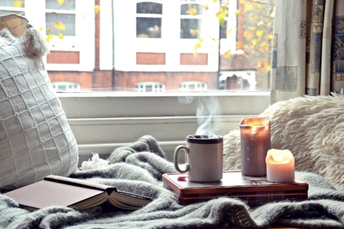 Cozy Scene on Bed with book and candle and hot drink.jpg