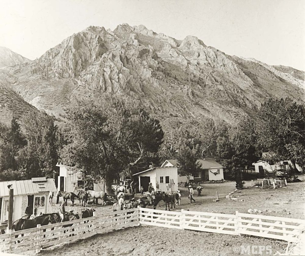 Getting ready to ride into the wilderness: a vintage view of McGee Creek Pack Station c.1950