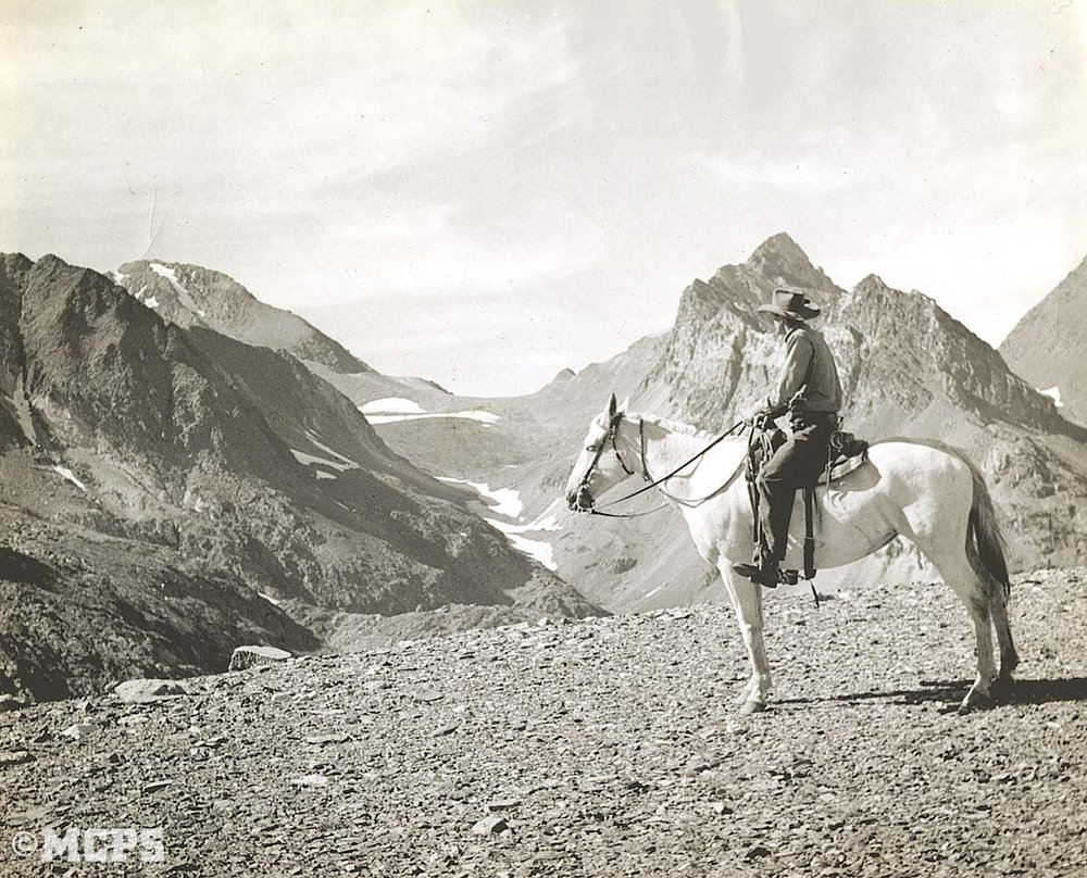 A horse in the wilderness: Lou Roeser as a young packer pauses to take in the view on Hopkins Pass. Thanks to his beautiful horse! C. 1950