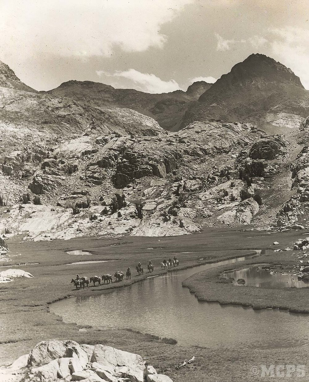 Packmules and guests travel along upper Fish Creek in the wilderness along the Sierra Divide