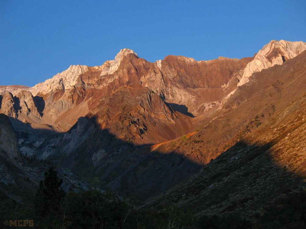 View from McGee Canyon as the rising sun touches Mt. Aggie and Baldwin Peak