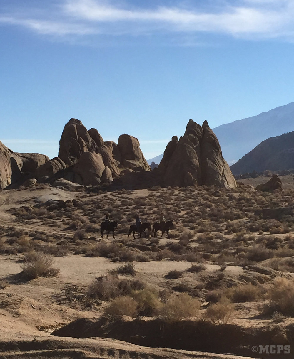A party of riders explores the incredible geology of the Alabama Hills