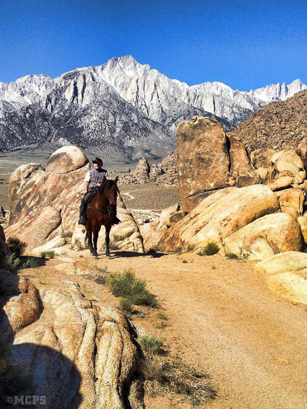 Mt. Williamson provides a dramatic backdrop for a horseman in the Alabama Hills.