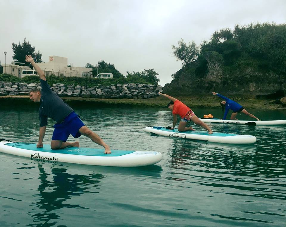 SUP YOGA - Currently available at Kadena Marina until November. Come experience a unique workout that is both a challenge and an adventure!