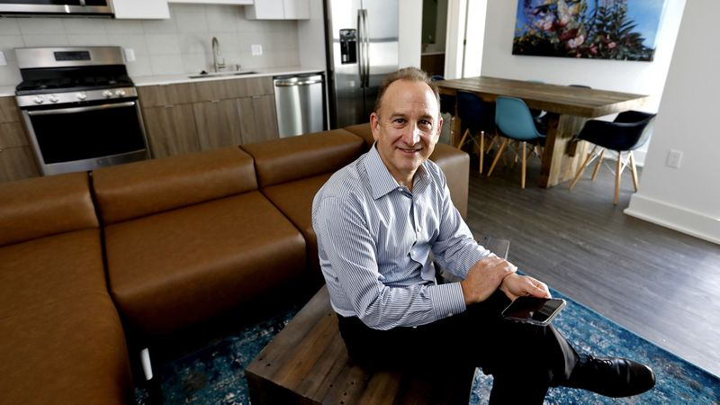 Ken Kahan, founder and president of California Landmark Group, sits in a common living area in a C1 co-living unit. (Gary Coronado / Los Angeles Times)