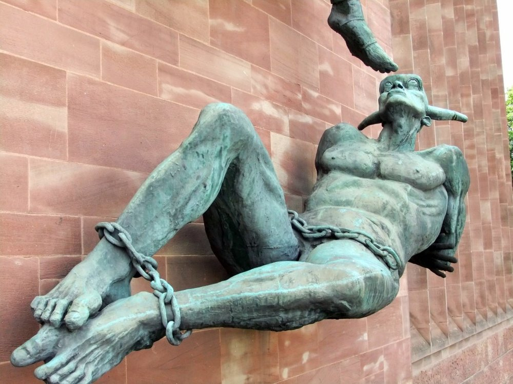 devil-bound-heel-statue