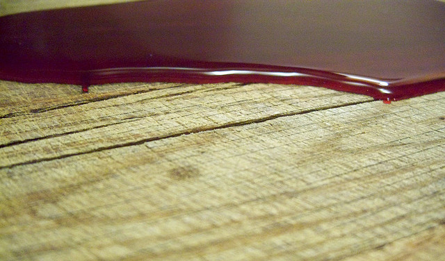 'blood puddle on wood' by Jo Naylor | License: CC BY 2.0