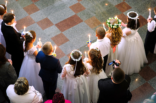 'First holy communion in church, many little children' by YaroslavUrban/Shutterstock.com | License - Shutterstock.com