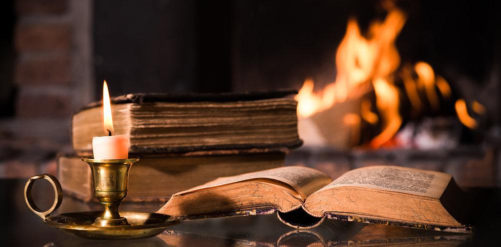 shutterstock_165712469-Bible_candle_fireplace-1500x739.jpg