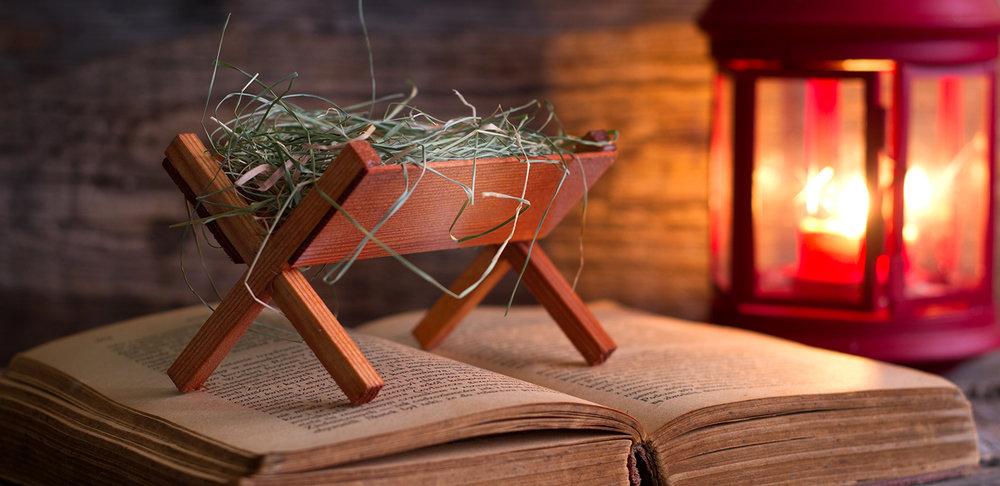 shutterstock_521699410-Christmas_manger_feed_trough_bible_light-1500x729.jpg