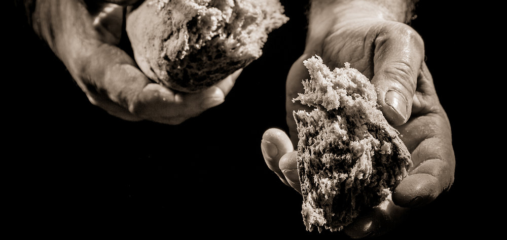 shutterstock_96334541-bread-breaking-hands-1500x711.jpg
