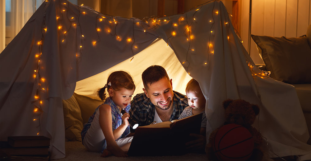 shutterstock_562341886-father_children_tent_reading-1500x778.jpg