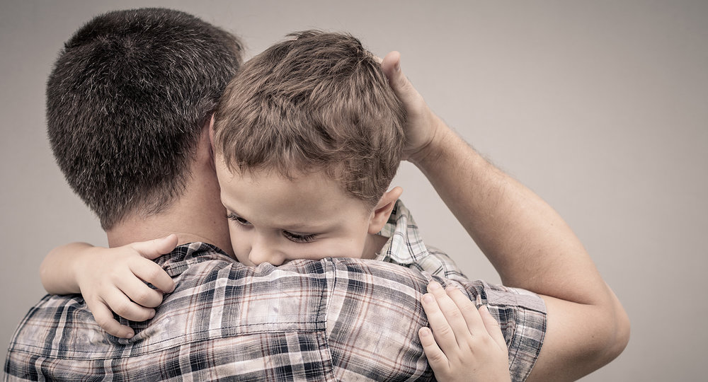 shutterstock_307289285-father_holding_son-1500x810.jpg