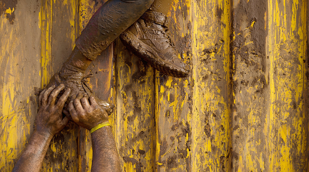 shutterstock_303723557-hands_feet_mud_helping_lift_climbing-1500x835.jpg
