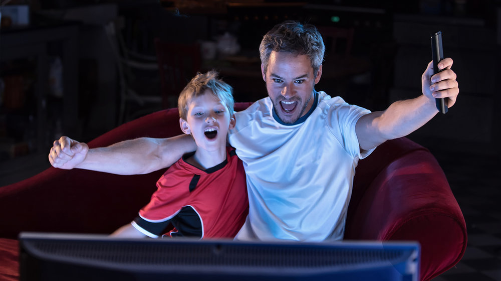 shutterstock_436722586-father_son_tv_cheering_night-1500x840.jpg