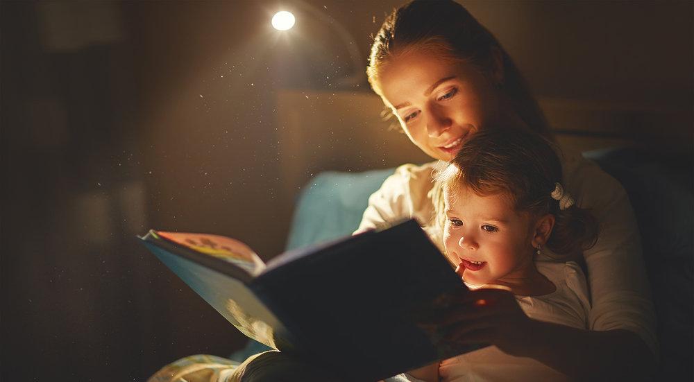 shutterstock_504740302-mother_daughter_reading_bedtime_story-1500x827.jpg