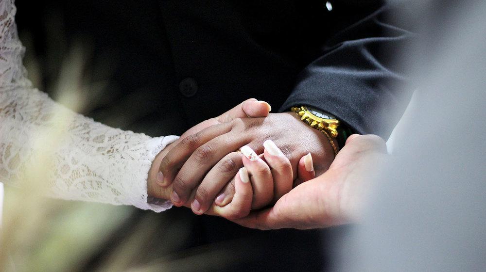 wedding-holding-hands-1500x841.jpg