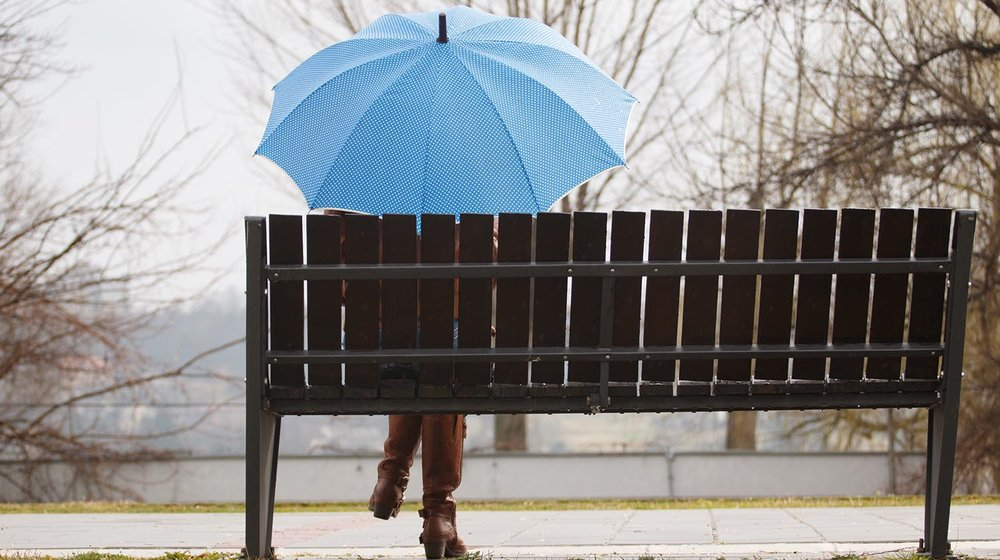 shutterstock_381141379-woman_park_umbrella_bench-1500x840.jpg
