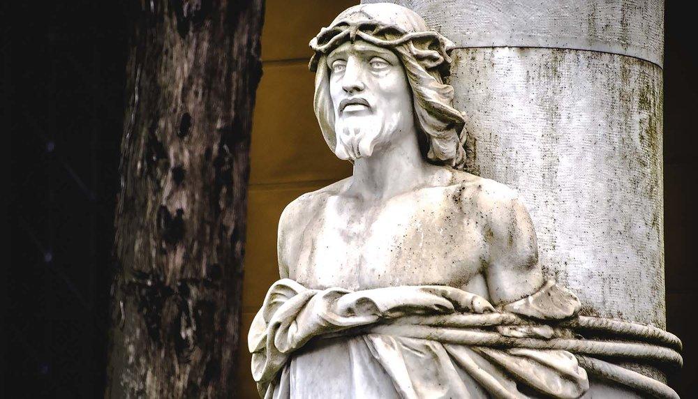 shutterstock_517304344-statue_Christ_bound-1500x858.jpg