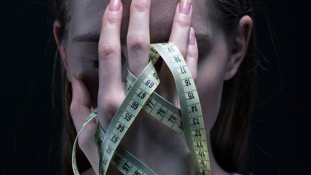shutterstock_513321970-anorexic_girl_covering_her_face_centimeter-1500x844.jpg
