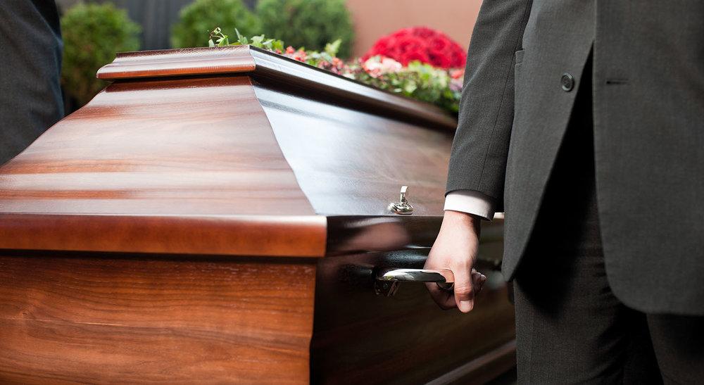 shutterstock_113984353-casket_pallbearer_death-1500x820.jpg