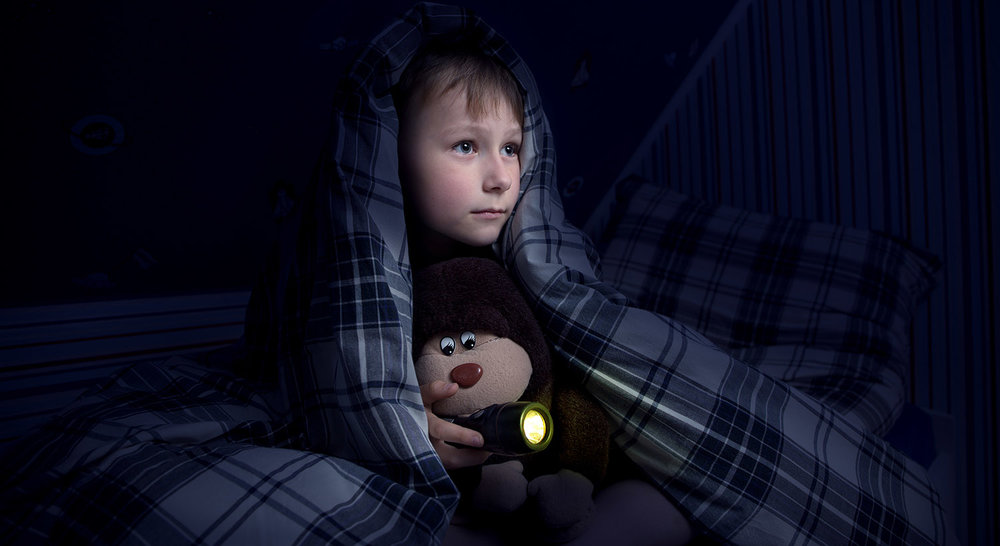 shutterstock_203688493-boy_scared_night_blankets-1500x819.jpg