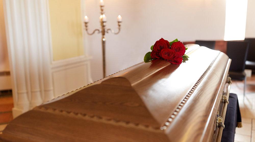 shutterstock_677360275-coffin_roses_funeral_home-1500x838.jpg