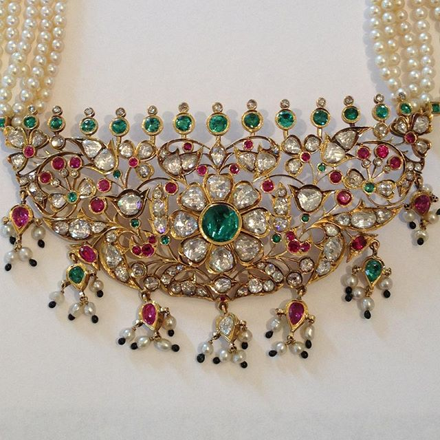 Merry Christmas and Happy Holidays to You and Yours!! Colors are perfect for Christmas.  While feasting for the holidays feast your eyes on this vintage South Indian piece encrusted with Golconda diamonds Colombian emeralds and Burma Rubies and Natural Pearls.  It's a piece from my private collection of Indian Jewelry.  #golcondadiamonds #colombianemerald #burmaruby #naturalpearls #southindianjewellery #southindia #jewelryporn #jewelerycollection #jewelrycollector #collector #estatejewelry #jewelryaddict #christmas #jewelrygram #india