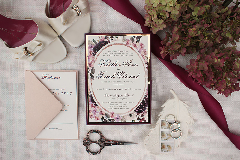 Rich red hues and watercolor floral gold mirror wedding invitations | Art Paper Scissors