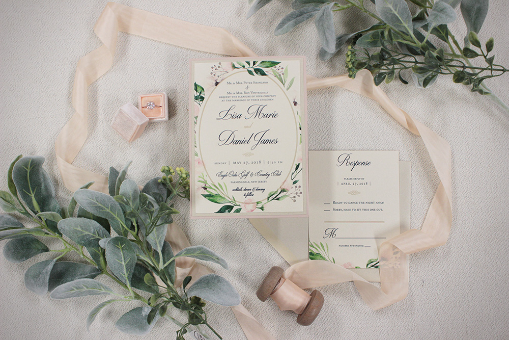 Romantic watercolor wedding invitation with blush florals and greenery
