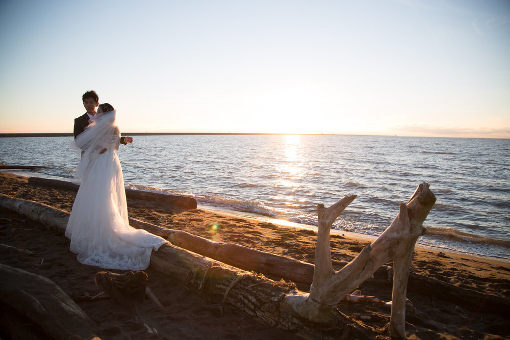 Bride and groom at Iona Beach for sunset