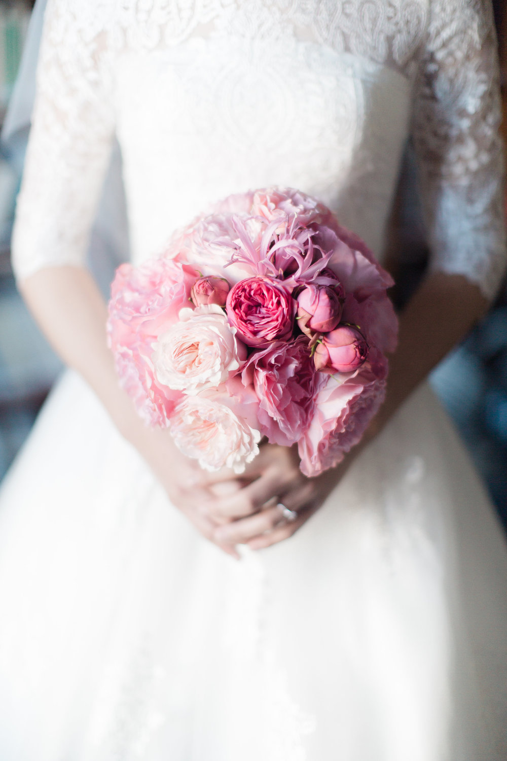 Bride holding her bouqet of pink flowers