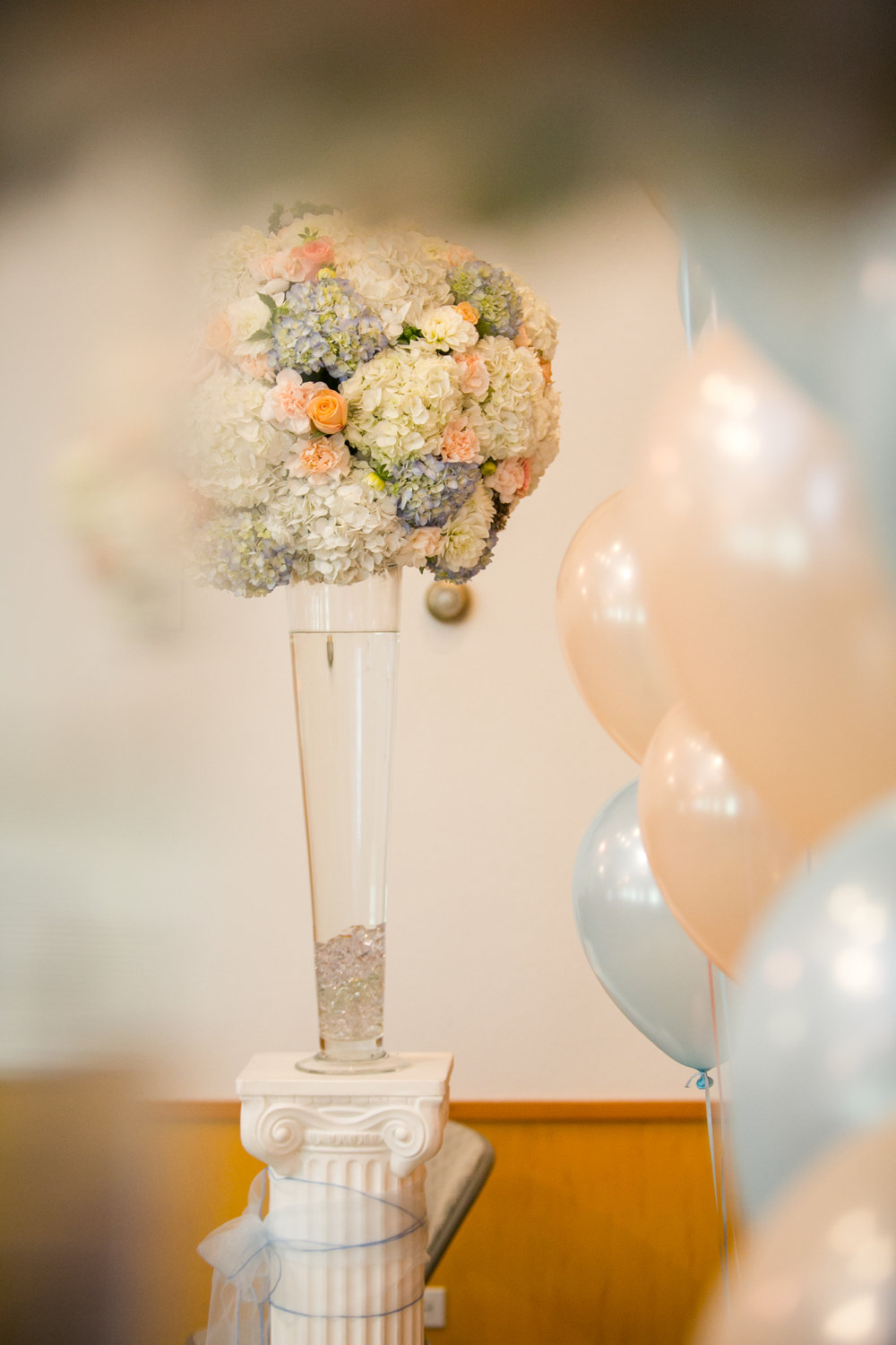 Balloons and large boquet of flowers for wedding decoration