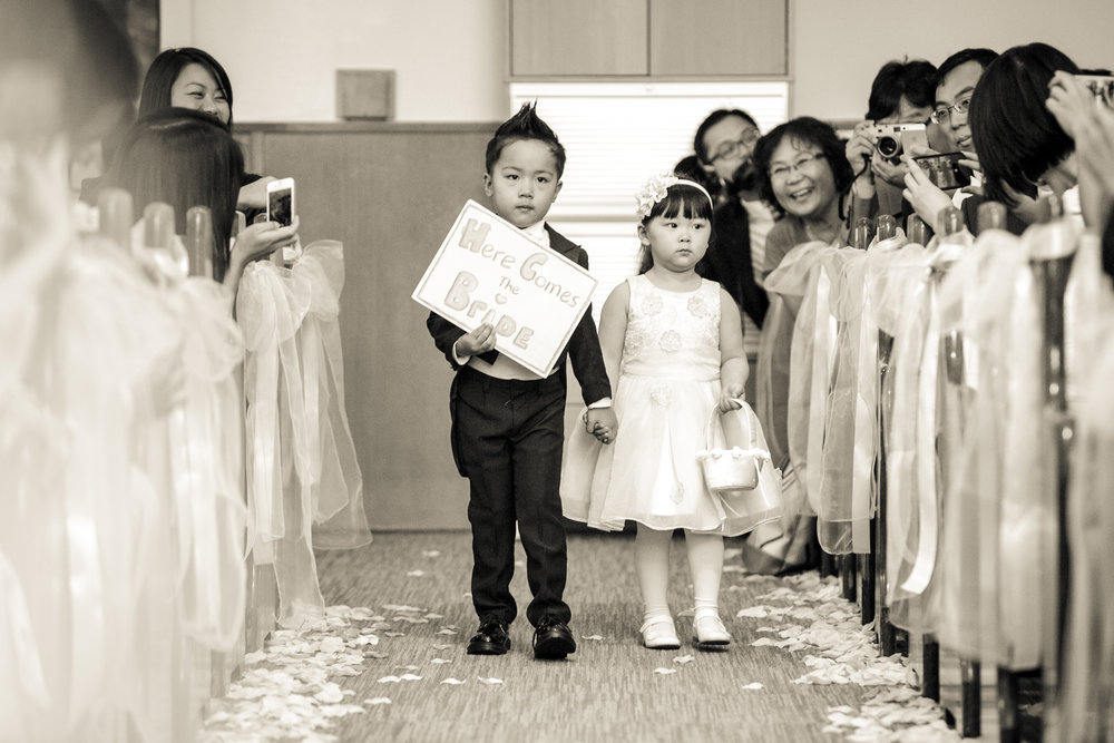 Ring bearer and flower girl walk down the aisle