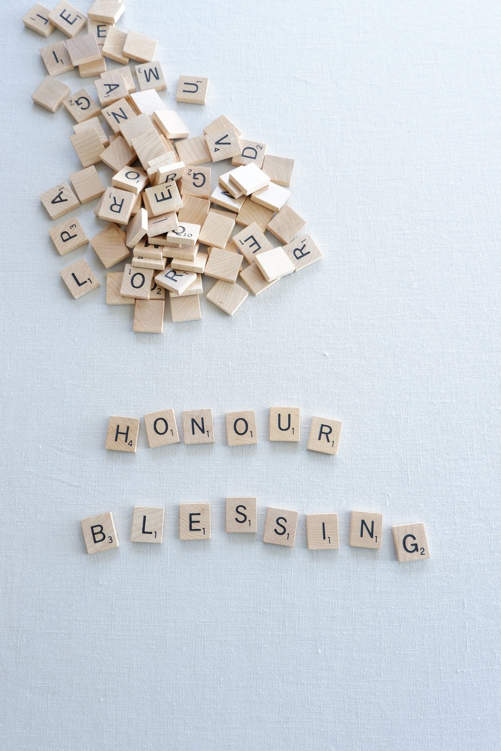 Spelling-out-honour-and-blessing-with-scrabble-tiles