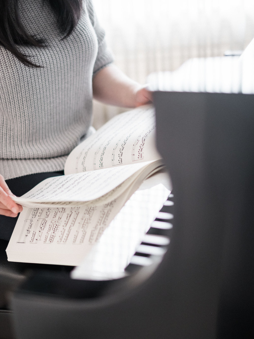 Flipping-music-at-piano