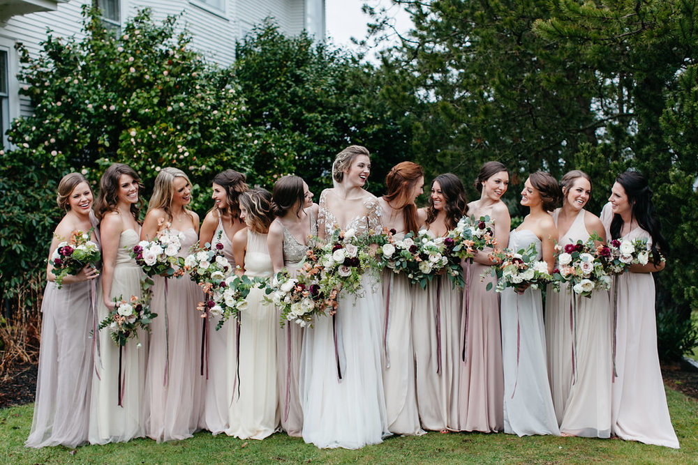 bride-laughing-with-her-twelve-bridesmaids