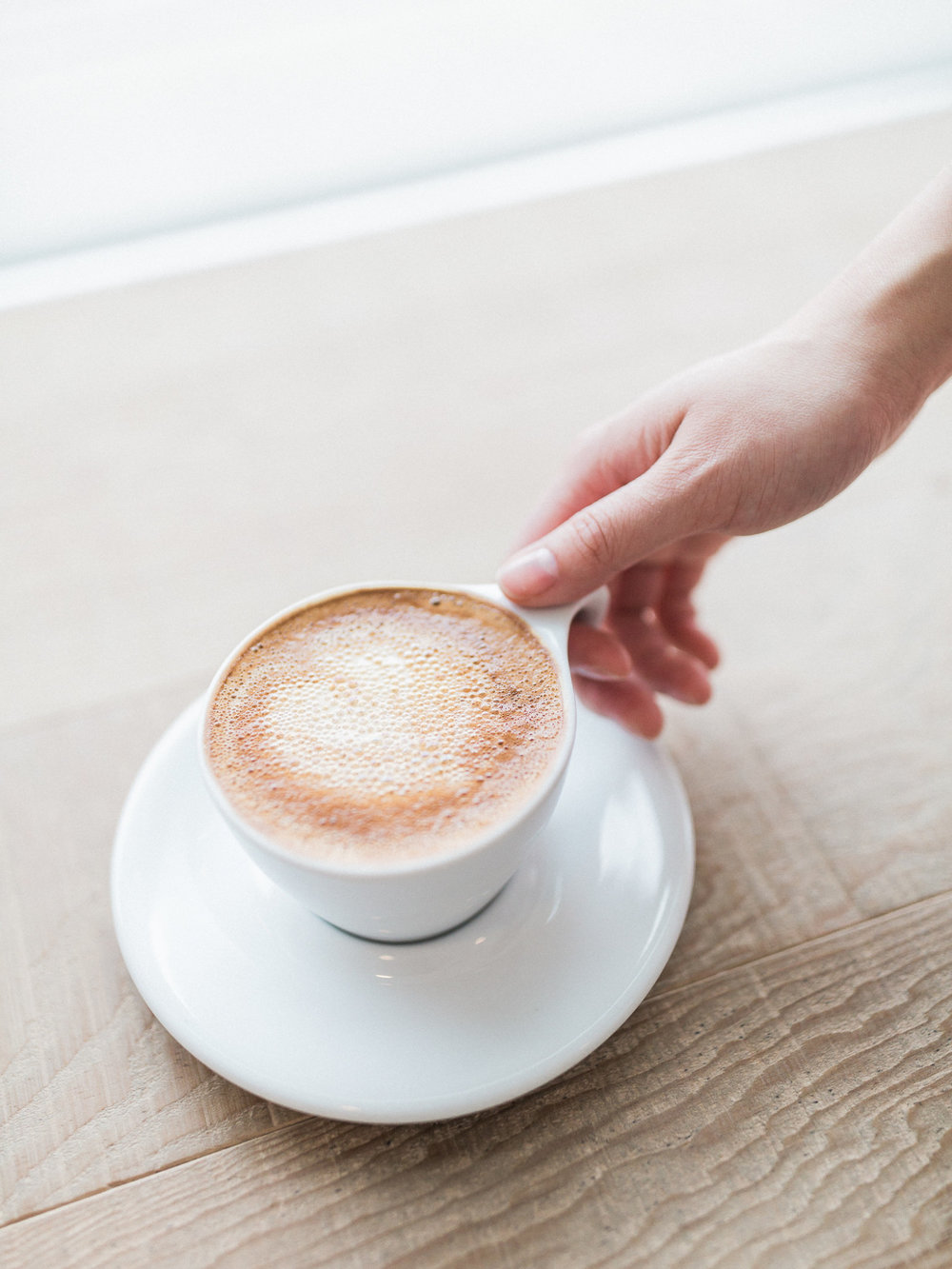 hand-holding-lifting-up-coffee-cup