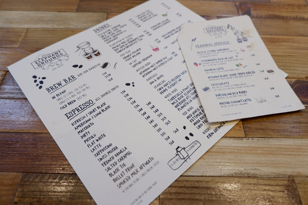 Paper-menu-on wooden-table-at-elephant-ground