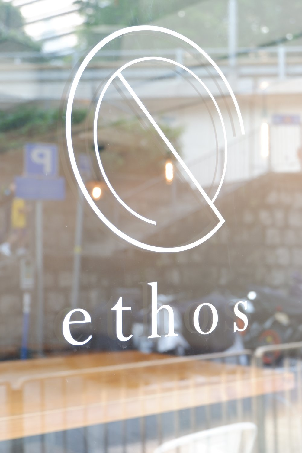 ethos-logo-design-on-glass