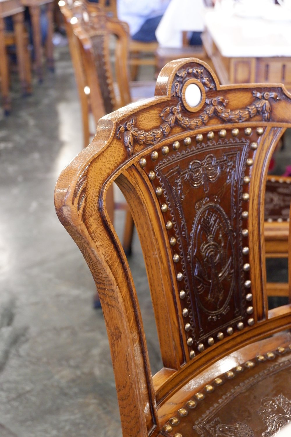 Close-up-of-wooden-chair-at-majestic-cafe