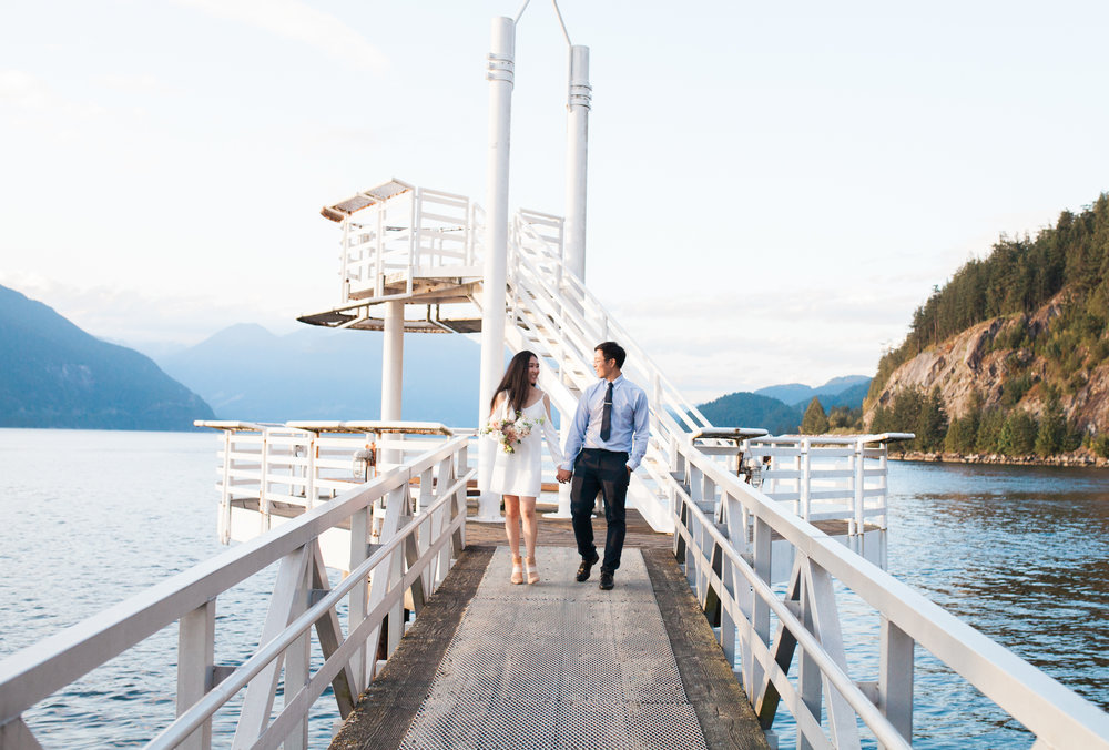 Couple-walking-down-the-dock