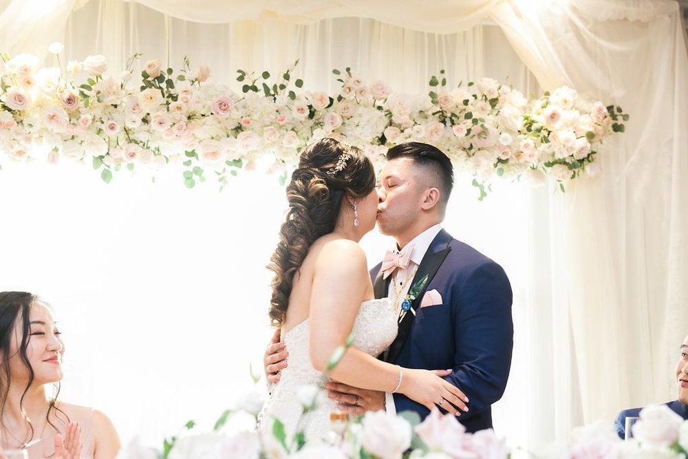 Kissing-under-floating-floral-installation