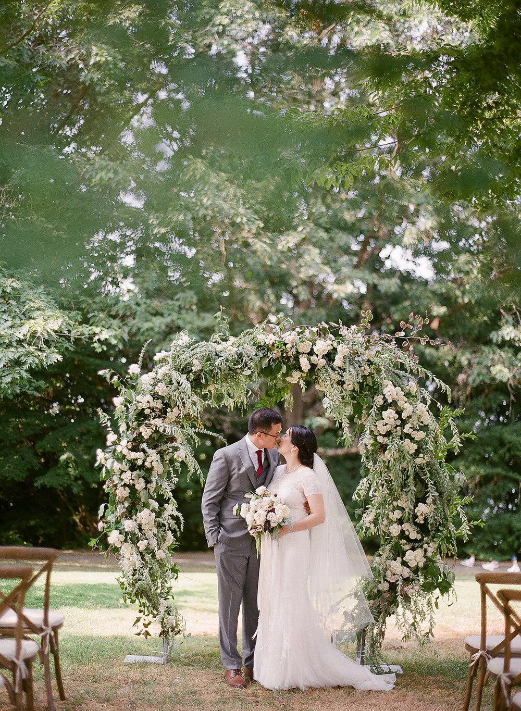 Queen-Elizabeth-Park-wedding-with-bride-and-groom-under-arch