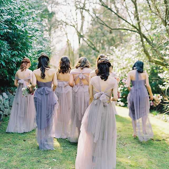 The bride's entourage. We love this beautiful capture by @jenhuangphoto of our bride's team in these gorgeous @jennyyoonyc dresses. The warm light in the sky that floats through their airy dresses as they enter into garden creates a whimsical and dreamy aura. Can't wait to share more from this beautiful wedding!  Planning: @honourandblessing Photography: @jenhuangphoto Florals and design: @myrtleetolive Bridesmaids gowns: @jennyyoonyc Bridesmaids MUAH: @carolhungmakeup . . . . . . . #dreamy #sunlight #vancouverspring #bridalparty #bridesmaide #light #airy #floatingdress #jennyyoo #jennyyoobridesmaid #bridesmaidstyle #shadesofpurple #vancouverweddingplanner #destinationweddingplanner #vancouverwedding #hycroftwedding #springwedding #springinbloom #Magnolias  #gettingready #海外婚禮 #婚禮 #夢幻婚禮 #溫哥華婚禮 #honourandblessingevents