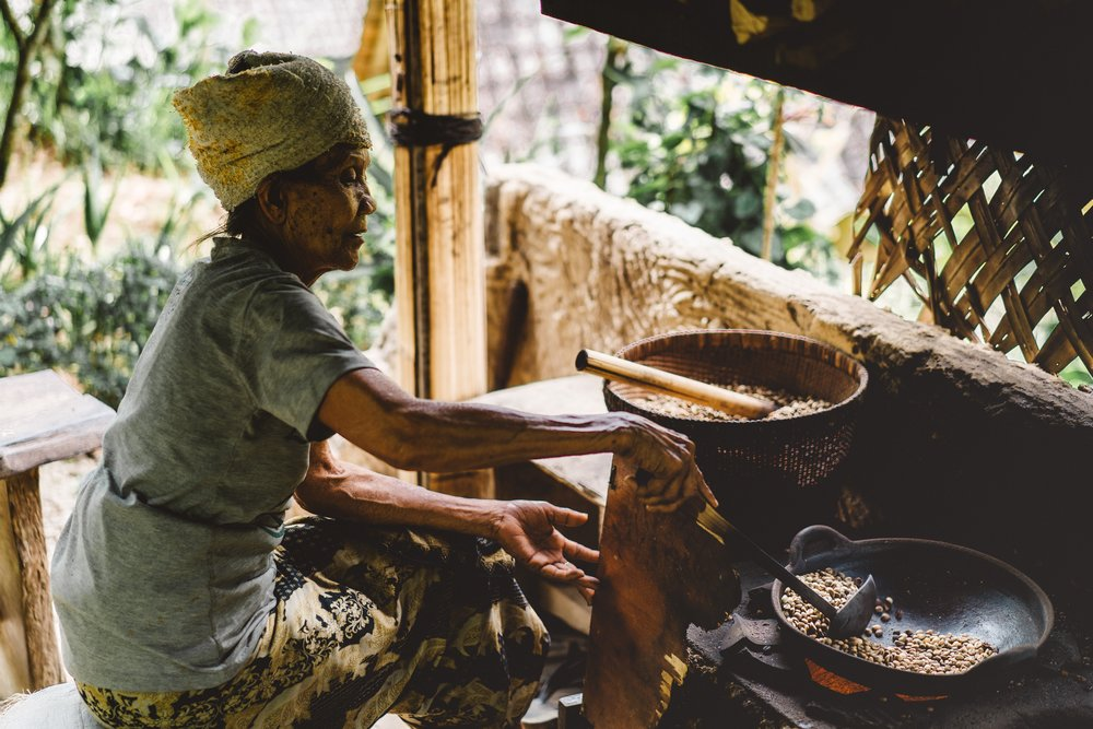 Woman cooking over traditional stove.jpg