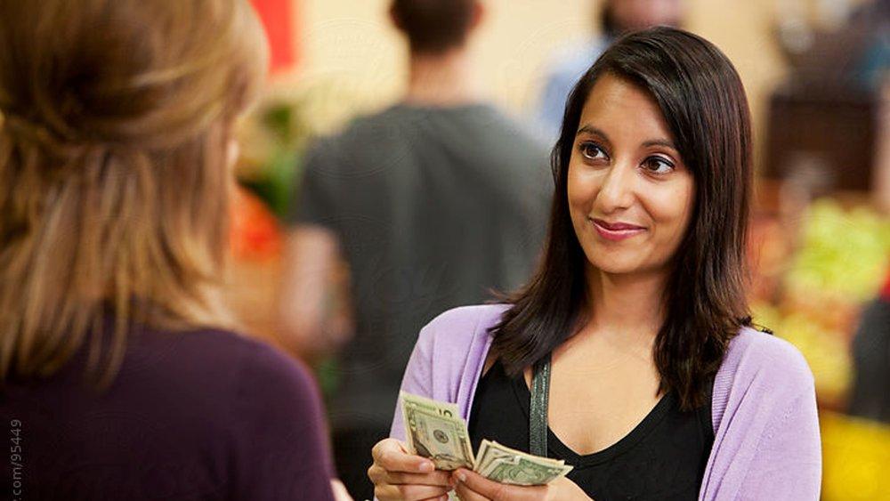Woman paying.jpg