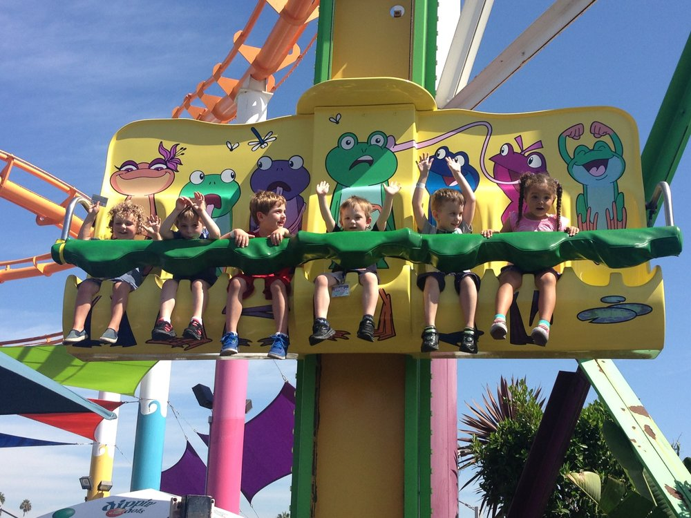 Hands in the air!  The children's rides at Santa Monica Pier Amusement Park.